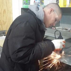 Josh Stafford, NLE Factory Trained Technician, makes a repair in the shop. His ability to think on his feet, as well as his vast knowledge from class work and on-the-job experience makes him a great person to have on your team!