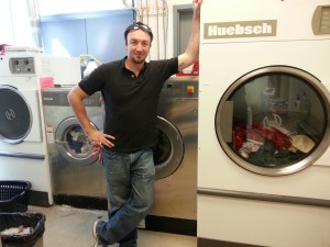 Jon Pell proudly displays an OPL laundry system we installed at a large veterinary clinic.