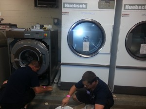 Josh and Jake install the Tennessee Titans' new OPL laundry system.
