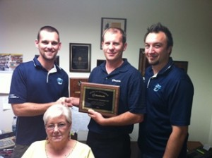 "Us getting the ""Award for Excellence."" We have a few plaques on the wall ;)."