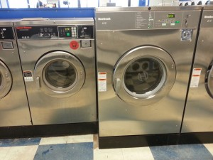 Here is a picture of a Huebsch 60# coin laundry machine sitting next to the Speed Queen 30#. Note the attractiveness and clean lines of the machine controls. Much more thought put into the actual customer experience on the Huebsch side.